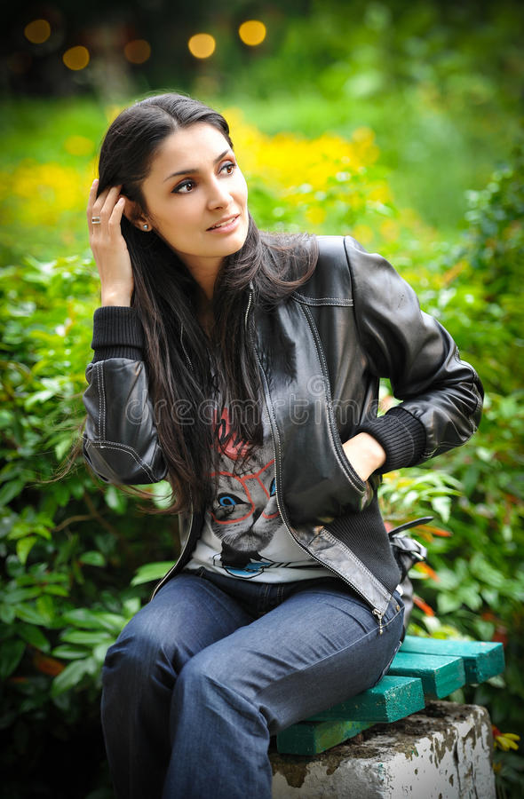 Portrait of a beautiful woman with long hair and leather jacket stock photos