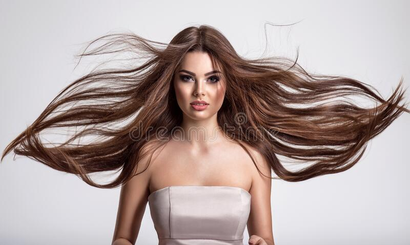 Portrait of a beautiful woman with a long hair royalty free stock photo