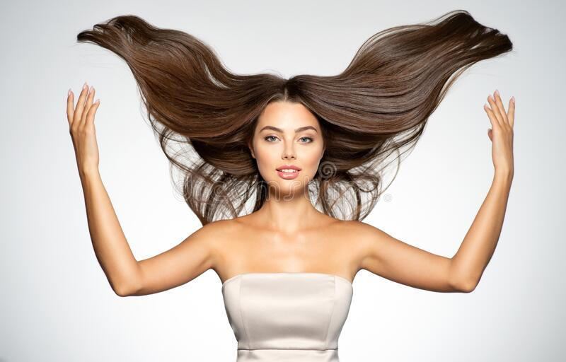 Portrait of a beautiful woman with a long straight hair royalty free stock images