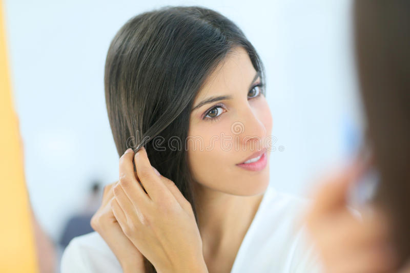 Portrait of beautiful woman looking at miror stock photo