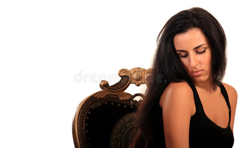 Portrait of a beautiful woman in a luxury chair stock images