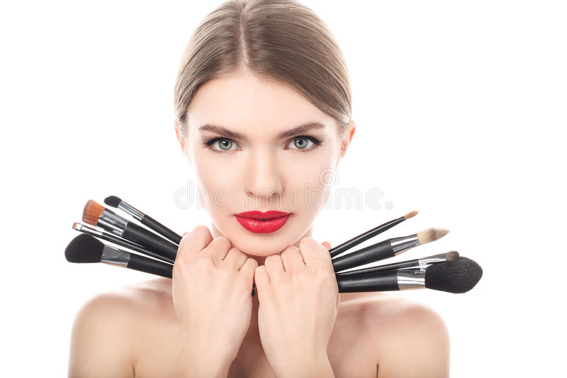 Portrait of the beautiful woman with make-up brushes stock image
