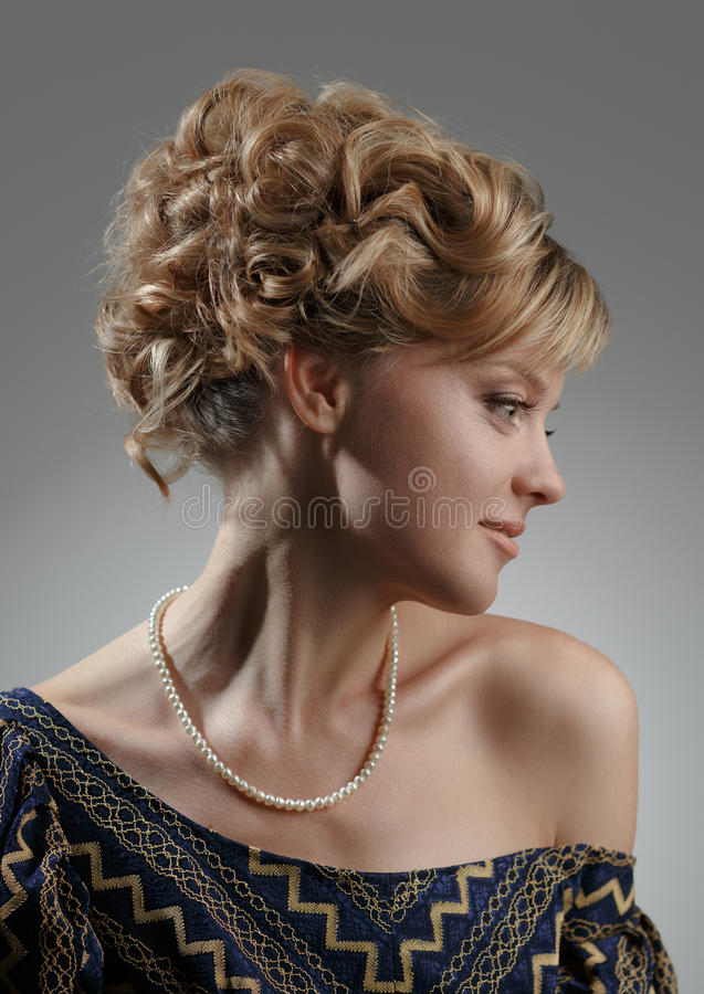 Portrait of a beautiful woman. Natural beauty. Updo. royalty free stock photography
