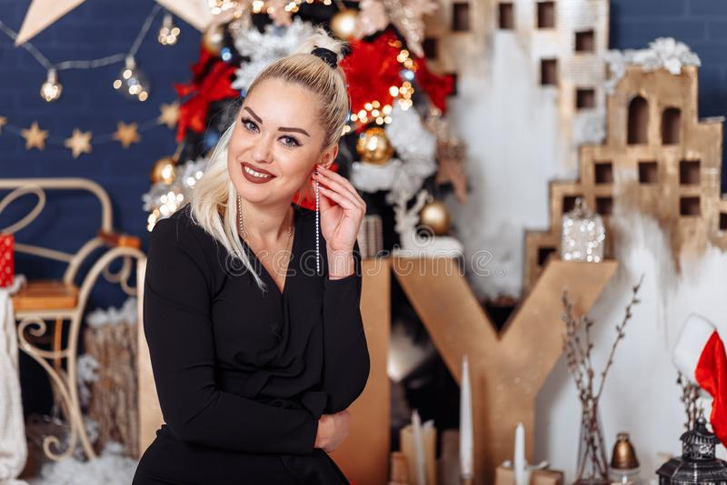 Portrait of a beautiful woman on New Year`s Eve royalty free stock photo
