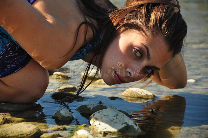 Portrait of a beautiful woman next to the river royalty free stock photography