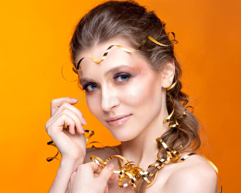 Portrait of a beautiful woman on an orange background. royalty free stock photo