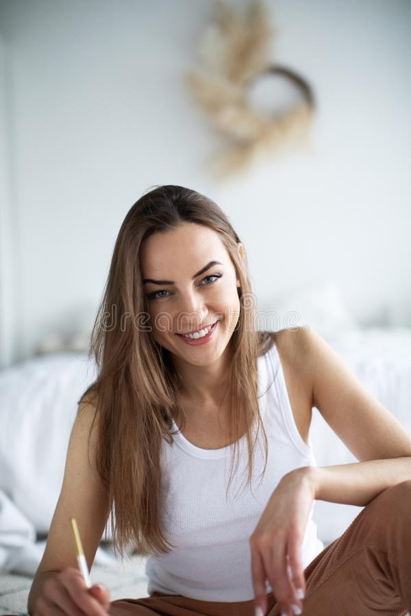 Portrait beautiful woman painter at home stock image