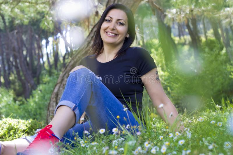 Portrait of beautiful woman in the park royalty free stock images