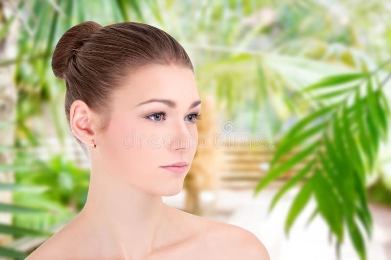 Portrait of beautiful woman with perfect skin over green background royalty free stock photos