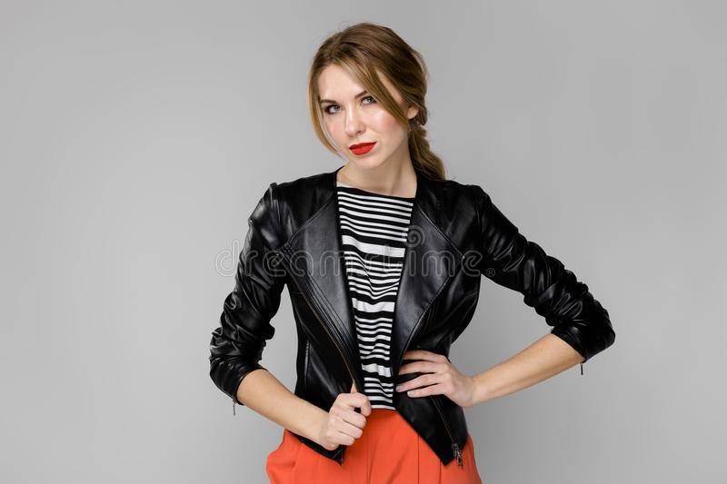 Attractive woman in fashionable clothes royalty free stock photo
