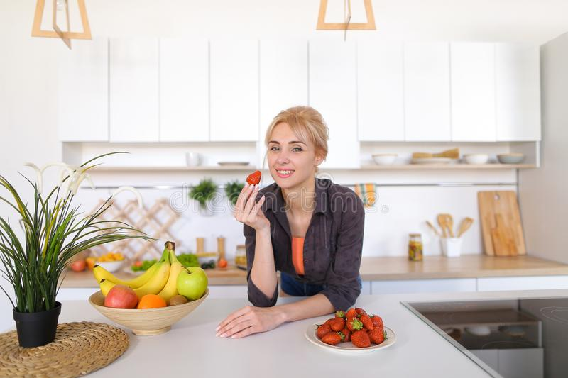 Portrait of beautiful woman posing in good mood with plate of st royalty free stock photo