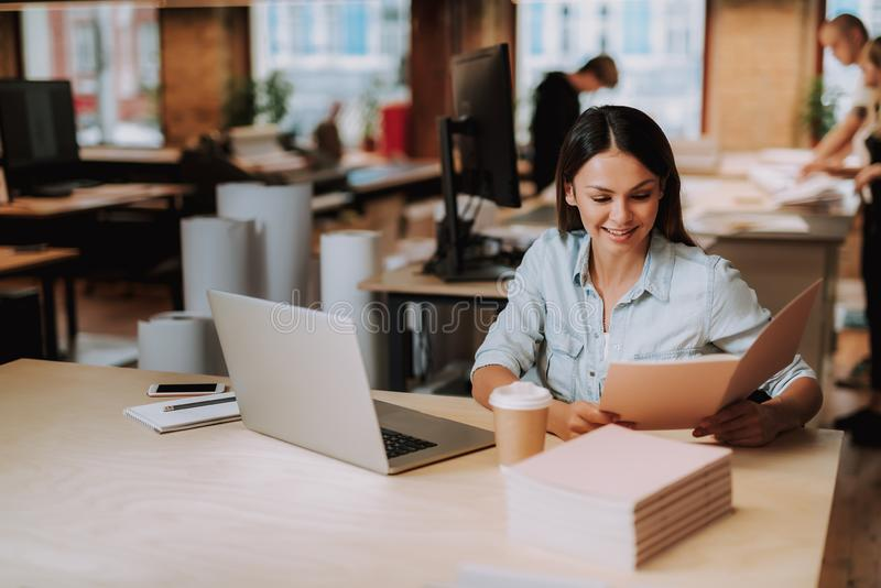Charming young lady working at modern office royalty free stock photos