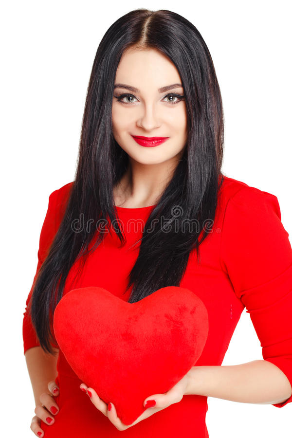 Portrait of a beautiful woman with red heart in hands. stock photo