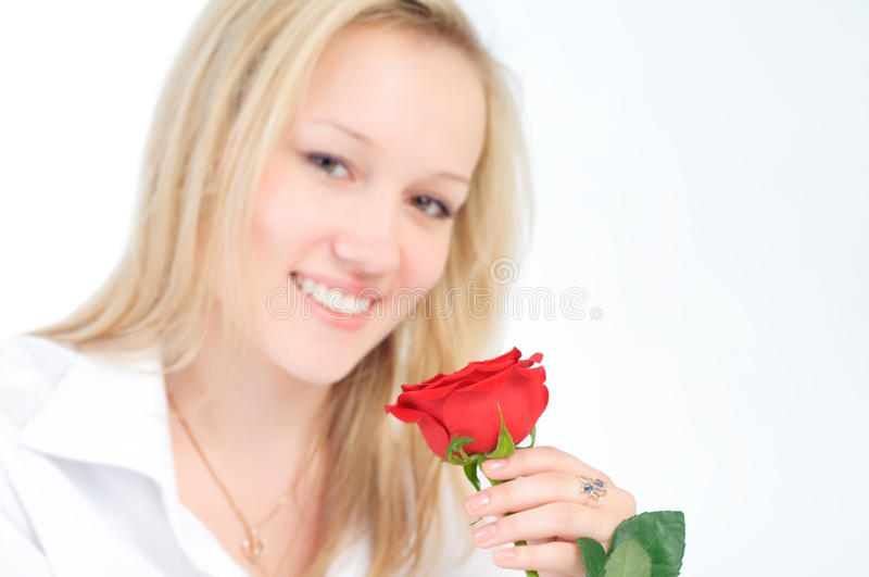 Portrait of a beautiful woman with a red rose.