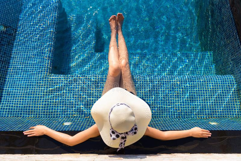 Portrait of beautiful woman relaxing in swimming pool, Summer ho royalty free stock photos