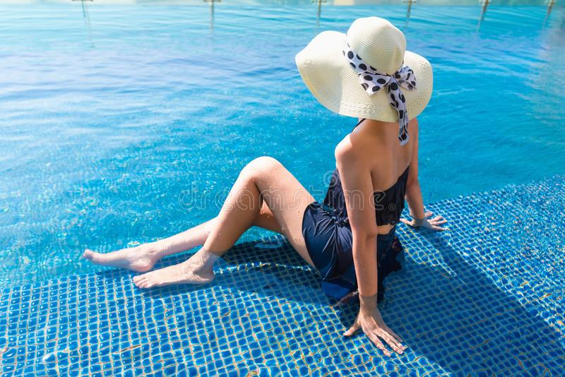 Portrait of beautiful woman relaxing in swimming pool, Summer ho stock image