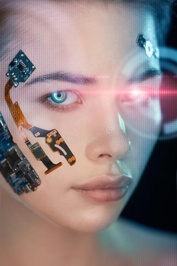 Portrait of a beautiful woman`s face with half human face and half face robot. Portrait of a beautiful cyber woman`s face with half human face and half face stock photos