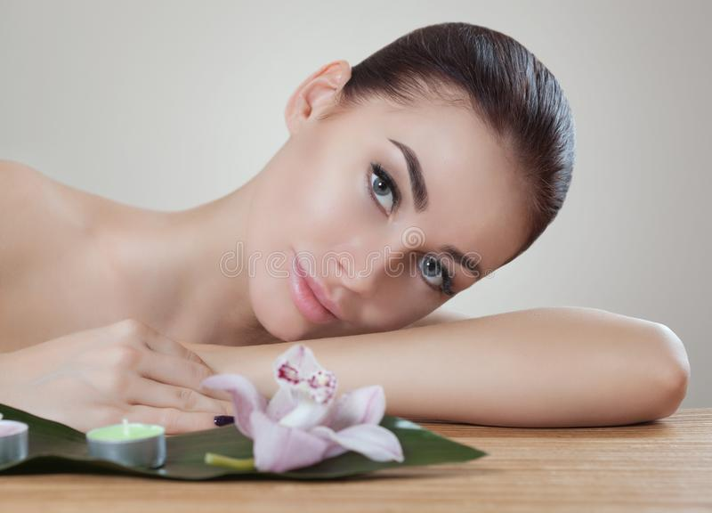 Portrait of a beautiful woman in a spa salon in front of a beauty treatment. royalty free stock photography