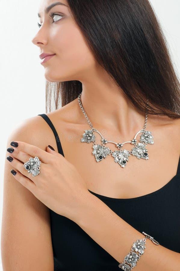 portrait beautiful woman with stylish accessory and jewelry. White studio background stock photography