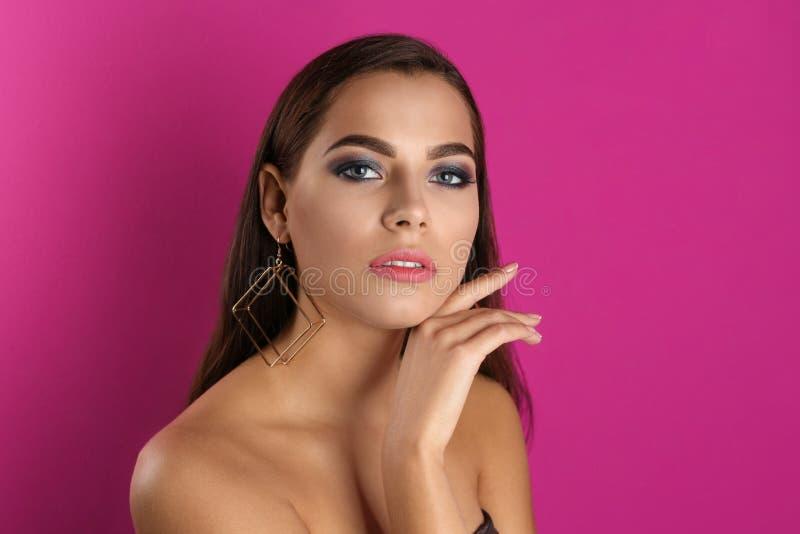 Portrait of beautiful woman with stylish makeup stock photo