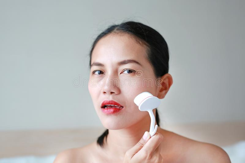 Portrait of beautiful woman using fine make up brush for face massage. Beauty Concept royalty free stock photos