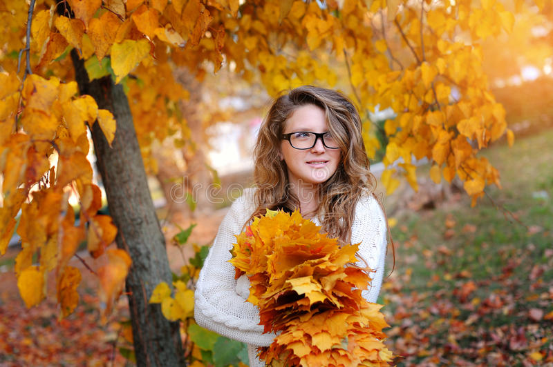 Portrait of beautiful woman wearing fashion glasses during the autumn stock photography