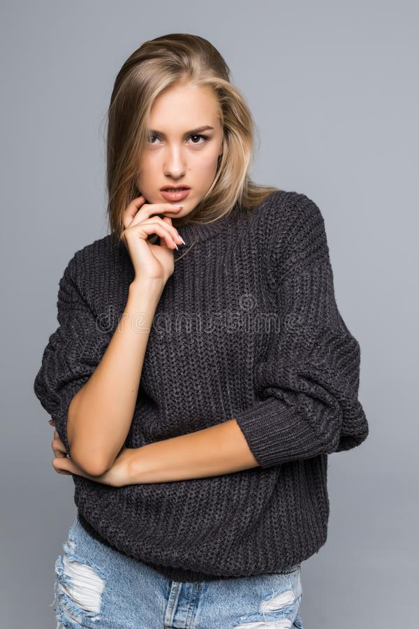 Portrait of a Beautiful Woman wearing a Warm knit Sweater on a gray background isolated royalty free stock photography