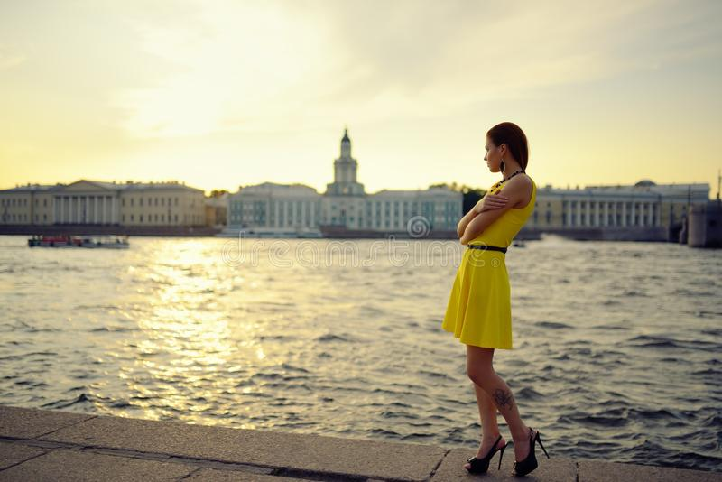 Download Portrait Of The Beautiful Woman In A Yellow Dress On The Embankment In Sankt Petersburg At Sunset Stock Image - Image: 43509421