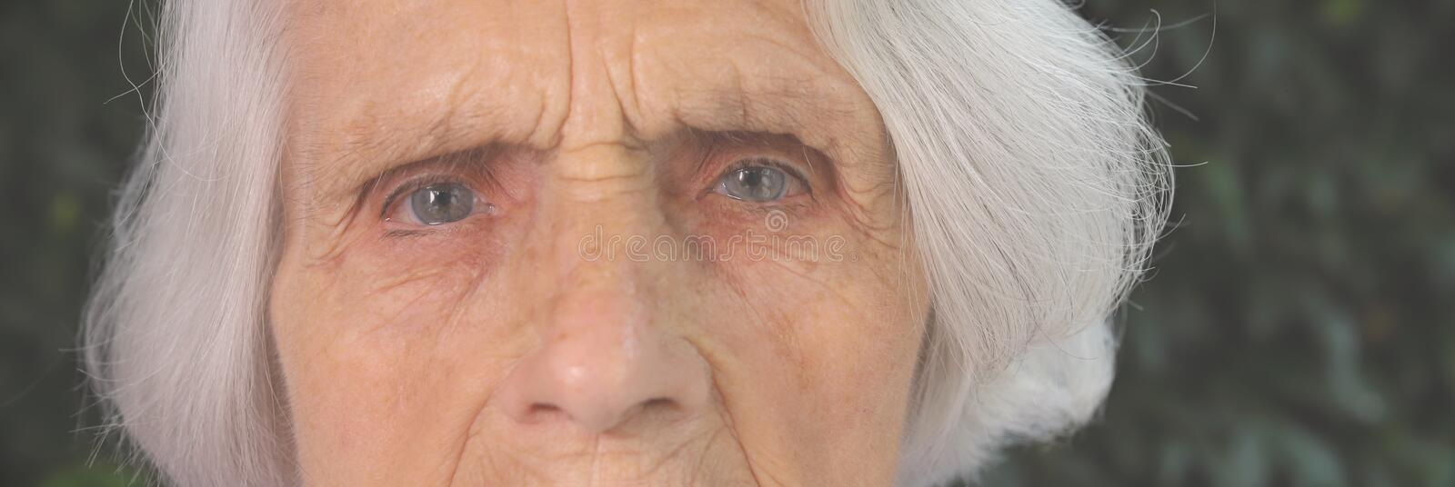 Portrait of a beautiful 90 year old woman. Upset thoughtful mature woman, feeling unwell, lost in thoughts, dementia or stock image