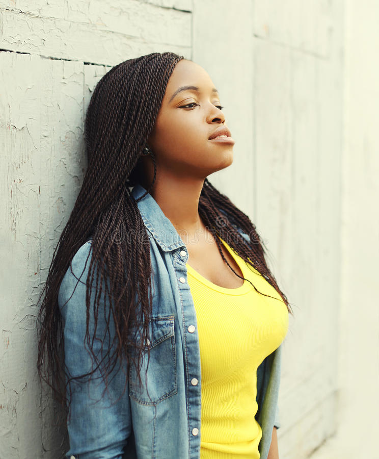 Portrait of beautiful young african woman in city stock photo