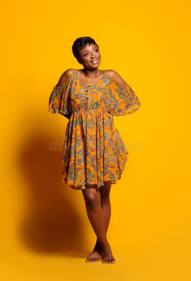 Portrait of a beautiful young African woman over yellow background. Studio picture royalty free stock photos