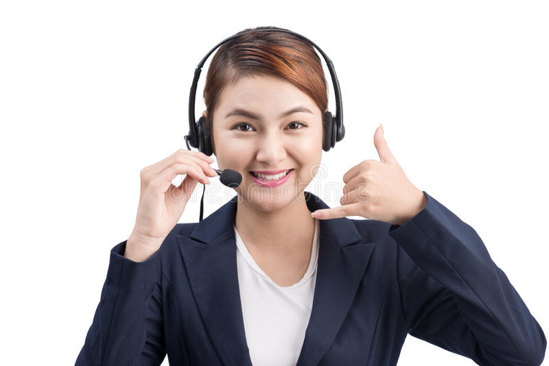 Portrait of beautiful young asian female customer service representative in headset looking at camera and smiling while isolated royalty free stock photos