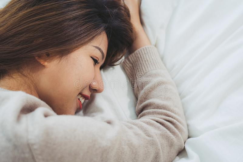 Portrait beautiful young Asian woman on bed at home in the morning. royalty free stock images