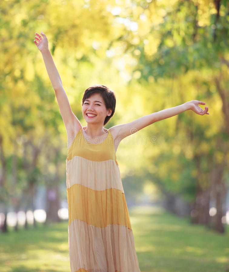 Portrait of beautiful young asian woman feeling free with relaxi stock photography