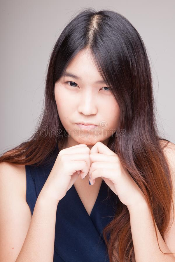Portrait of beautiful young Asian woman. Portrait of beautiful young Asian woman on gray background royalty free stock photo
