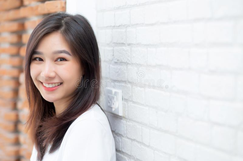 Portrait of beautiful young asian woman happiness standing on gr royalty free stock photo