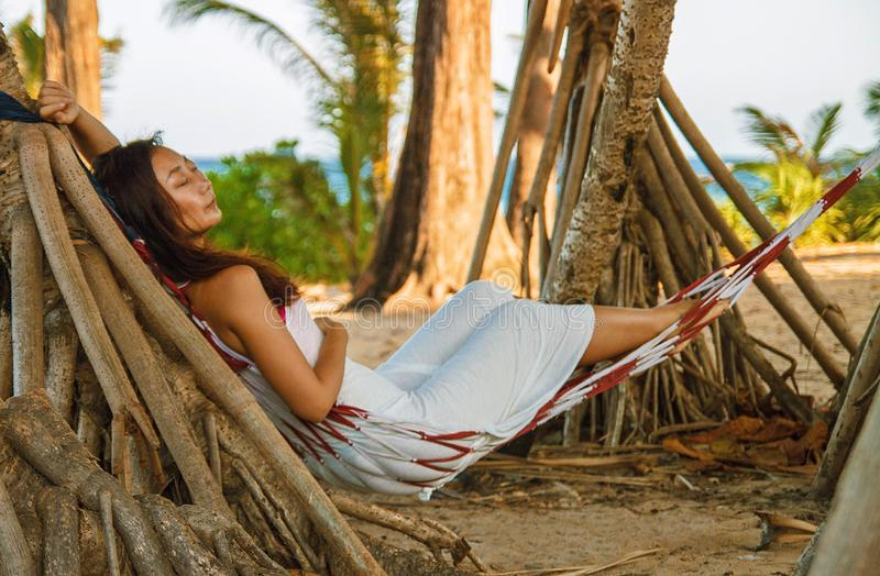 Portrait beautiful young asian woman happy smile leisure on hammock swing around the beach sea and ocean with blue sky white cloud stock photo