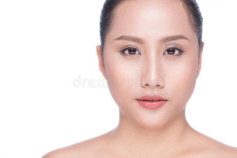 Portrait of beautiful young asian woman looking at camera. Natural beauty concept royalty free stock photography