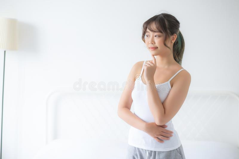 Portrait of beautiful young asian woman makeup of cosmetic, girl happy and smile attractive. Face of beauty perfect with wellness in the bedroom at home with royalty free stock photography