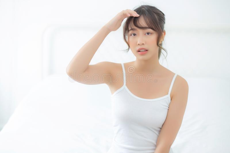 Portrait of beautiful young asian woman makeup of cosmetic, girl happy and smile attractive. Face of beauty perfect with wellness in the bedroom at home with royalty free stock images