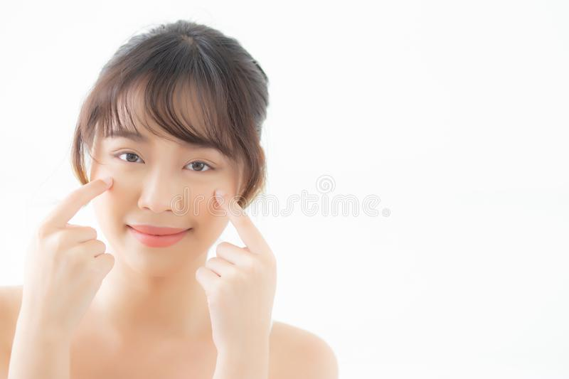 Portrait of beautiful young asian woman smile healthy and wellness at the bedroom. Beauty asia girl skin care touch eye makup and cosmetic with happy with royalty free stock image