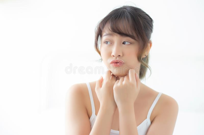 Portrait of beautiful young asian woman smile while wake up healthy and wellness with sunrise at morning in the bedroom. Asia girl skin care with happy with stock photos