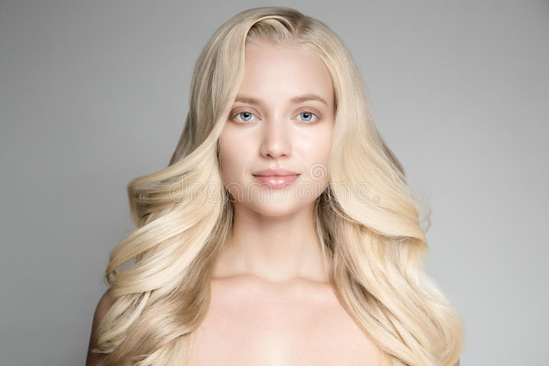 Portrait Of A Beautiful Young Blond Woman With Long Wavy Hair. stock images