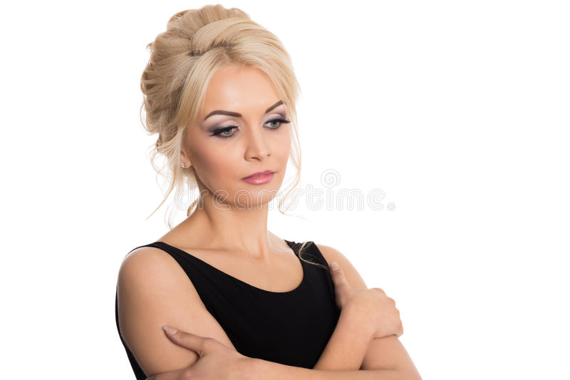 Portrait of a beautiful young blonde in a black dress stock photo