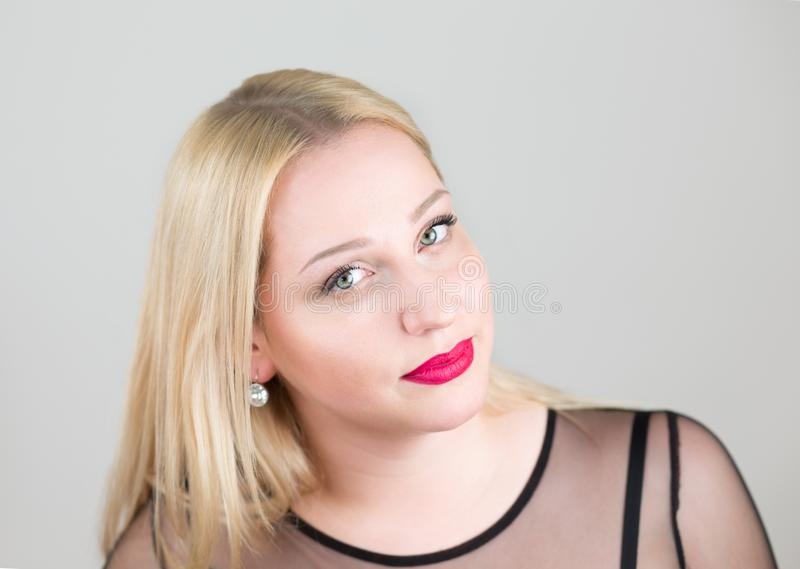 Portrait of a beautiful young blonde woman in an evening black dress close up. stock photos