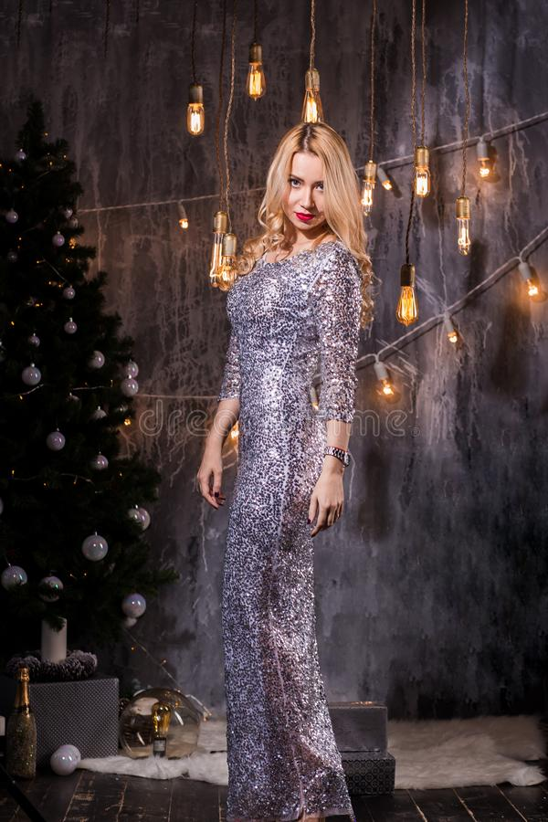 Portrait of Beautiful young blonde woman in evening dress. New Year, holiday, celebration, winter concepts royalty free stock images
