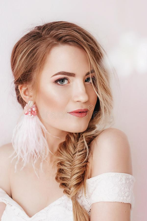 Portrait of beautiful young blonde woman with makeup stock photo
