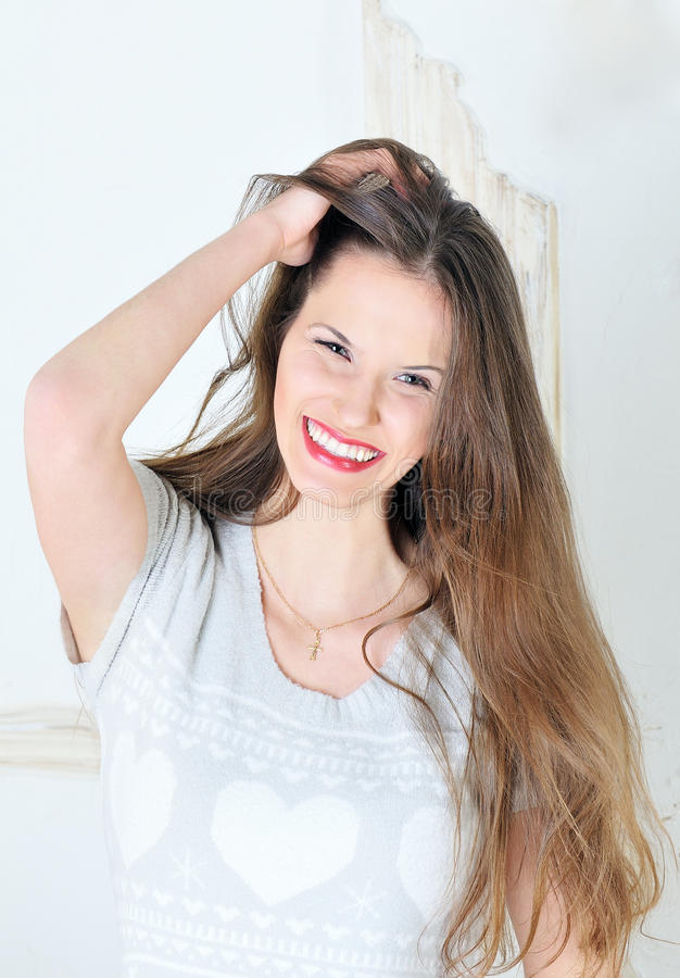 Portrait of beautiful young brunette smiling stock photos