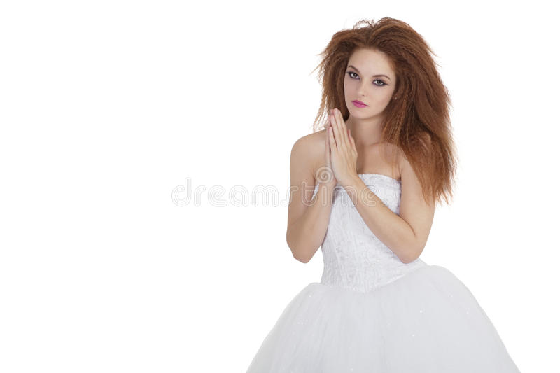 Download Portrait Of Beautiful Young Brunette In Wedding Dress With Hands Together Over White Background Stock Photo - Image: 29673180