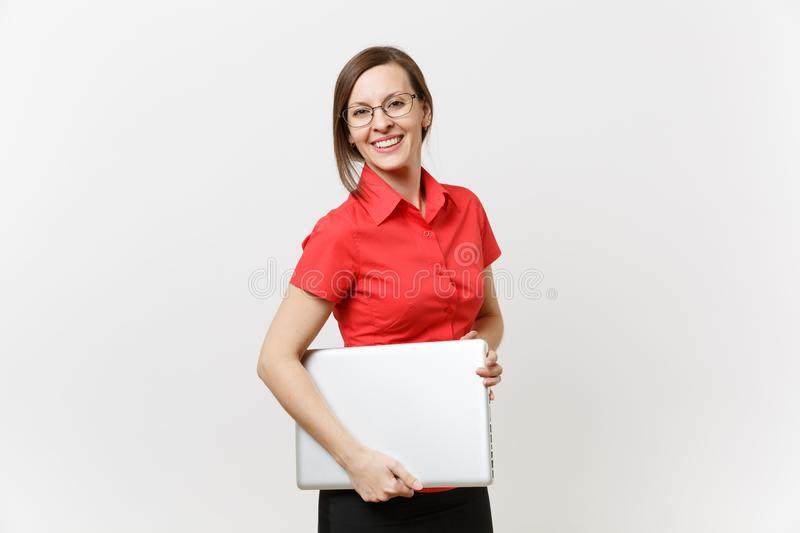Portrait of beautiful young business teacher woman user in red shirt, glasses holding laptop pc computer underarm. On white background. Education or teaching in stock images